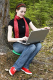 Working in a laptop. A beautiful girl working in a laptop royalty free stock photos
