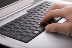Working on laptop Royalty Free Stock Image