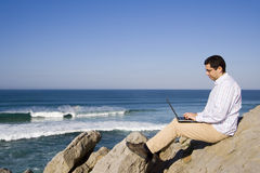 Working with the laptop at the beach Stock Photography