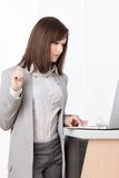 Working on the laptop businesswoman at the office Royalty Free Stock Photo