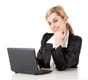 Working on laptop cheering businesswoman Stock Images