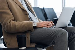 Working on laptop, close up of hands of business man royalty free stock images