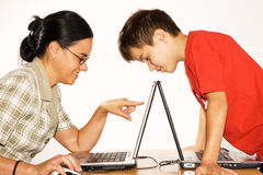 Working on laptop computer. Mother and her son working on laptop computer stock images