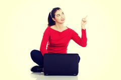Working on laptop computer and pointing up Royalty Free Stock Photos
