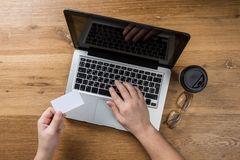 Man working in modern office with laptop. Top view royalty free stock photos