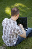 Working with laptop outdoor Stock Image