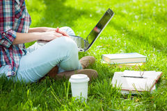 Working on laptop outdoors. Royalty Free Stock Images