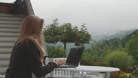 Working on Laptop Outdoors stock footage