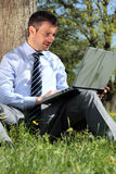 Working with laptop in a park Stock Photography