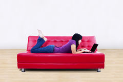 Working with laptop on sofa Stock Photography