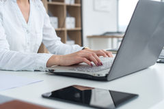 Working with laptop woman writing a blog. Female hands on the keyboard. royalty free stock photography