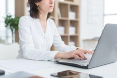Working with laptop woman writing a blog. Female hands on the keyboard. Royalty Free Stock Photo