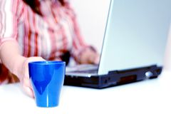 Working Late (isolated). A cup of cofee and a laptop Royalty Free Stock Photography