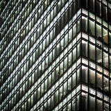 Working Late. Late night, full-frame detail view of the Bahn Tower, a contemporary office building in Potsdamer Platz, Berlin, illuminating the night sky royalty free stock image