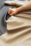 Working with leather. A person work leather to make a sofa royalty free stock photo