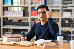 Working in a library Royalty Free Stock Images