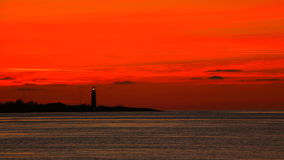 Working lighthouse on the background of beautiful Royalty Free Stock Images