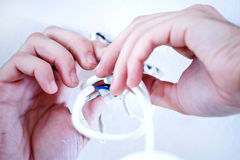 Working on lighting wires. Male hands working with electring wiring for lighting Royalty Free Stock Image