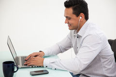 Working and listening to music Stock Photos