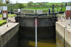 Working Lock, River Severn, Tewkesbury, Gloucestershire, UK. Working lock on the River Severn near the disused flour mill in Tewkesbury, Gloucestershire, England Royalty Free Stock Image