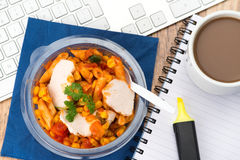 Working lunch at the office desk Royalty Free Stock Photography