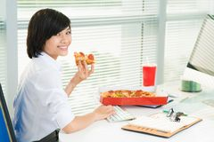 Working at lunchtime Royalty Free Stock Image