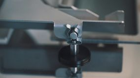 Working machine metal piston part at manufacture facility stock footage