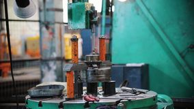 Working machine metal rod falls on the material and rises. Mid shot stock footage