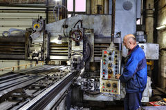 Working machine operator controls the processing of metal Royalty Free Stock Photos