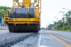 Working machine for road construction royalty free stock photography