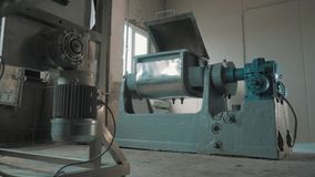 Working machine-tool with open lid at empty bright manufactory. Working grey and blue metal industrial machine-tool with open lid at empty bright manufactory stock video footage
