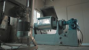 Working machinery bench with open lid at empty bright factory room. Working grey and blue metal industrial machinery bench with open lid at empty bright factory stock video