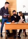 Working in male dominated job. Woman attractive lady working with men colleagues. Office collective concept. Coworkers. Communicate solving business tasks royalty free stock photography