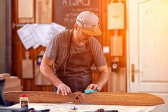 Experienced carpenter working royalty free stock photography