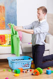 Working man cleaning house Stock Image