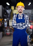 Working man demonstrating his workplace and tools at workshop Royalty Free Stock Photos