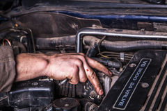 Working man fix engine. Working men with dirty hands and tools Royalty Free Stock Photography