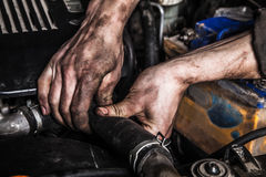 Working man fix engine Stock Images