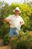 Working man with  garden pruner Royalty Free Stock Photo