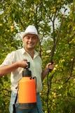 Working man with garden spray Royalty Free Stock Photos