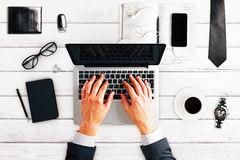 Working man with laptop, cup of coffee, glasses and other access Royalty Free Stock Photos