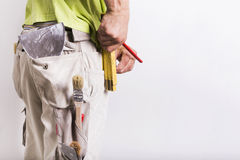 Working man with masonry and painting tools. Renovation home interior Stock Photos