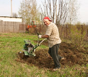 Working man with motor cultivator Stock Photo