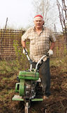 Working man with motor cultivator Royalty Free Stock Image