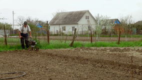 Working man with motor cultivator. stock video