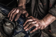 Working man near engine Royalty Free Stock Images