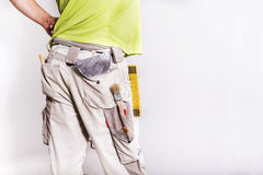 Working man pants with tools. Renovating home interior. Working man pants with tools Stock Photo