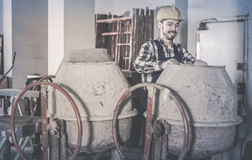 Working man practicing his skills with mixing unit at workshop Royalty Free Stock Images