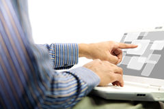 Working man push on notebook screen Royalty Free Stock Photo