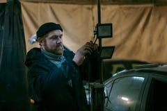 Working man with lamp repair stock photos